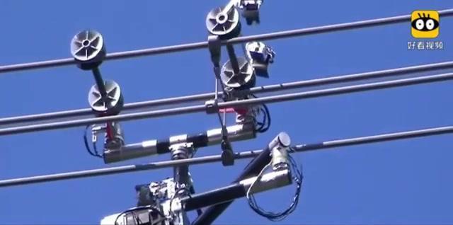 日本研发高压线巡检机器人 可24小时巡检电线